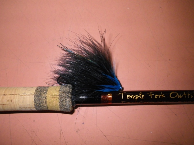 A black and blue marabou tube fly illicited the most response by Michigan steelhead. ©Nicholas J. Conklin, Temple Fork Outfitters.