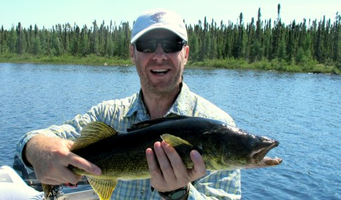 Chris with a Gangler's Lodge walleye on the first day. Photo courtesy of BKnoble.